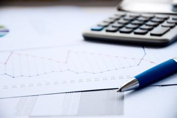 Ball pen, the calculator, documents