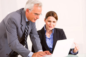 businessman and businesswoman during a meeting