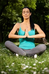 Young female practicing yoga in nature