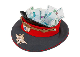 Police cap with money on  white background