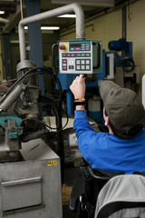 Man with disability operated an industrial machine