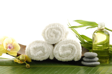 Spa treatment- stones towel and bamboo leaf