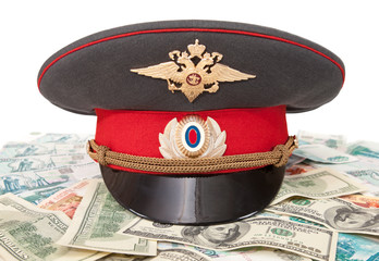 Police cap and money on white background