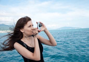 Pretty girl photographed sea