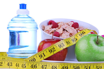 Diet weight loss concept with tape measure red apple