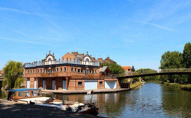 Boat house in the center of Amiens, France. On the shore of the