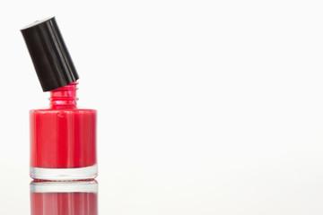 Close up of an opened nail polish flask