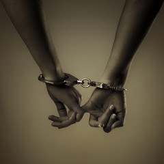 two girl hand and handcuffs
