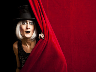 cabaret performer on stage looking at the audience