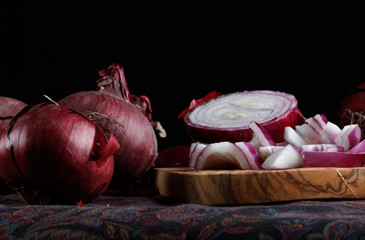 elegant red onion on black background