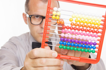 Business man calculating on abacus calculator