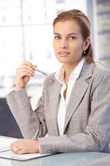 Pretty businesswoman sitting at desk