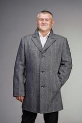 man dressed in gray wool coat