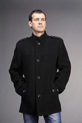 Portrait of handsome man in coat
