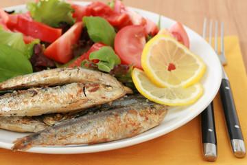 Fried sardines with salad