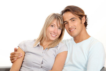 Portrait of in loved couple sitting on couch