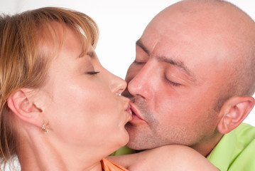 couple kissing on whte