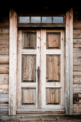 Old door in wooden cottage