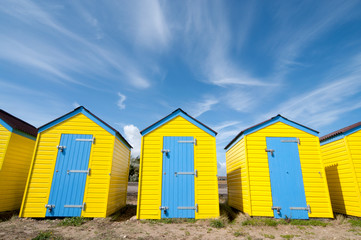 Yellow beach huts in summer