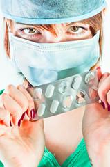 Beautiful doctor showing the pills you should take