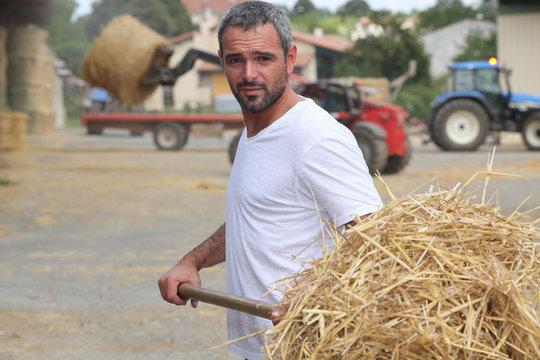 Farmer bailing hay