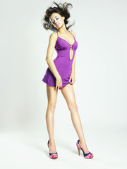 Beautiful young woman in lilac dress
