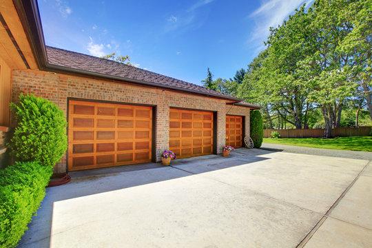 Three garage doors with luxury wood
