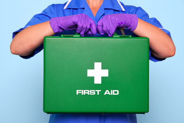 Nurse holding a first aid kit