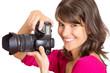 lachende Fotografin mit Kamera