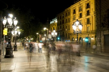 night scene tourists walking La Rambla Barcelona