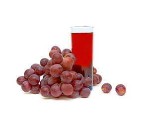 bunch of grapes and a glass of grape juice