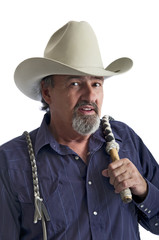 Cowboy with bullwhip on his shoulder