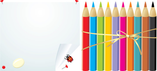 Colorful pencils on the convoluted paper with elastic