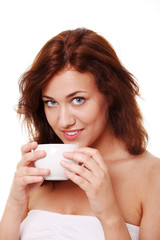 Young woman is having her tea/coffee