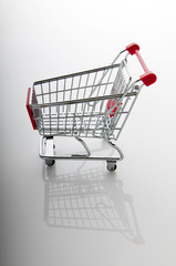 Shopping cart against the  background