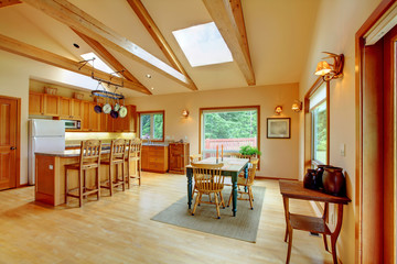 Large living room on the horse ranch with the kitchen.