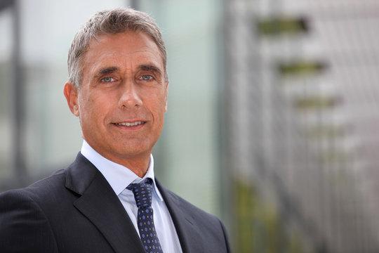 Business executive stood outdoors