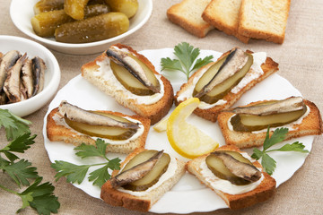 Sandwiches with sprats and ingredients to them