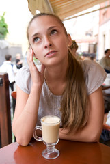 woman with coffee in cafe
