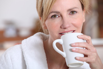 Woman drinking a cup of tea