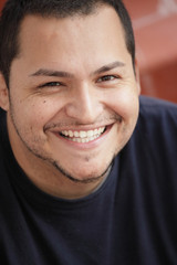 Young Latino male smiling
