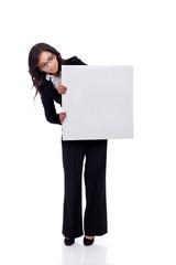 beautiful business woman holding a blank billboard