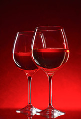 wine glasses on red background