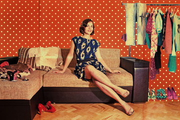 beautiful woman in retro room with fashion clothes