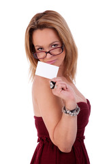 beautiful woman with blank business card in hand