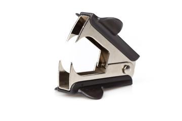 A black staple remover