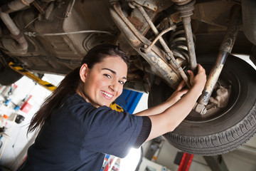 Portrait of smiling young female mechanic