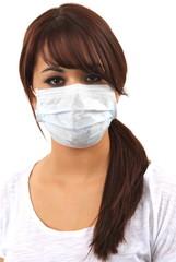 Junge Frau mit Mundschutz/ V