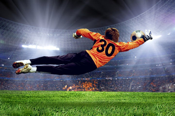 Poster Soccer ball Football goalman on the stadium field
