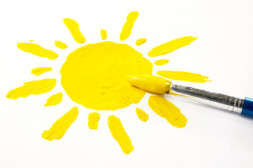 paintbrush and painted sun on white background.